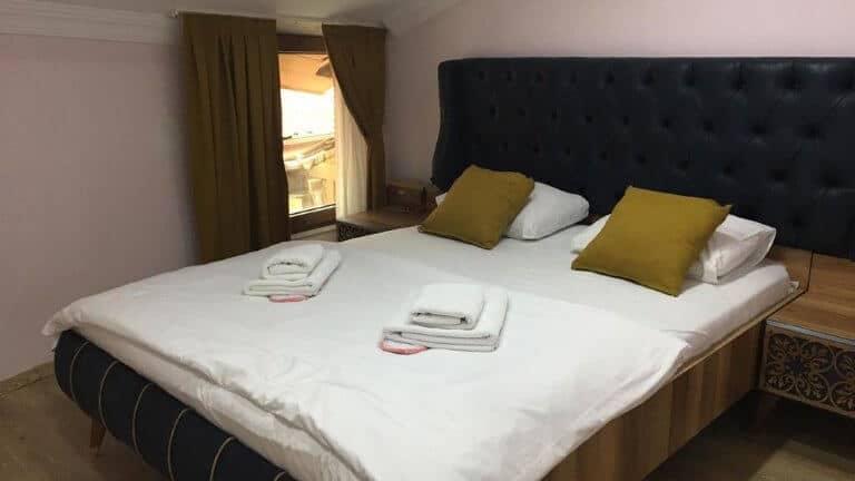 غرف فندق دنيا ريزيدنس اوزنجول