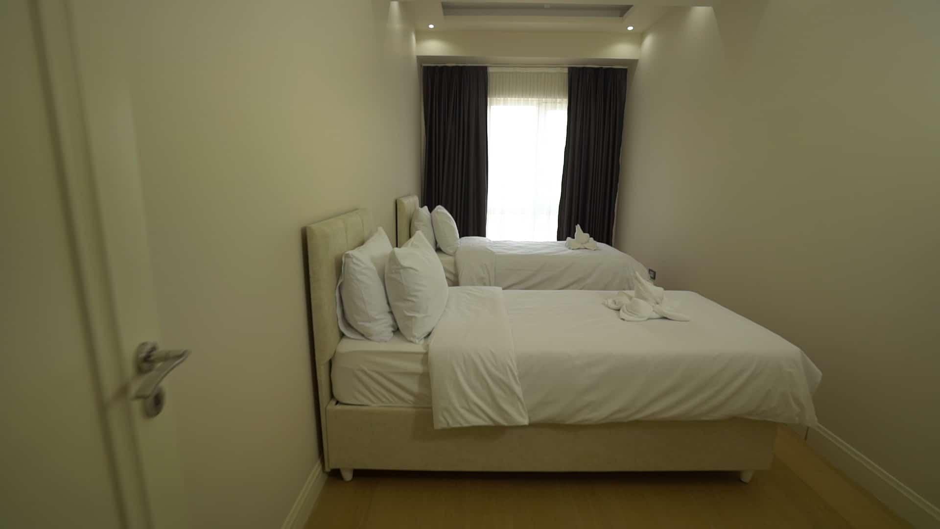 غرفة بسريرين في شقق للايجار في فينيسيا لمدة اسبوع غرفتين وصالون