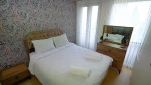 غرفة نوم بسرير مزدوج في شقق فينيسيا
